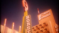 Downtown Las Vegas casinos, street scene, 3679 vintage film home movie Stock Footage