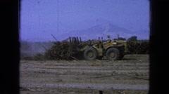 1965: yellow bulldozer farmer pushing brush clearing field slowly MEXICO Stock Footage