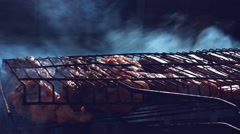 4k Food Composition of Barbecue Sausages in Smoke Stock Footage