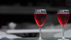 Two glasseses of rose wine dark background Stock Footage
