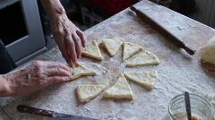 Woman making croissants from the dough Stock Footage