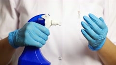 Disinfect latex gloves with spray. medicine and health concept in the hospital. Stock Footage