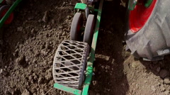 Tractor pulls machine for sowing peppers. Stock Footage