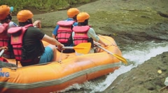 White water rafting in Bali, people on orange boat close up Stock Footage