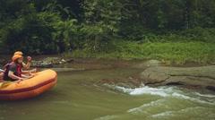 White water rafting in Bali, people on orange boat, medium shot Stock Footage