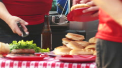 Tailgate: Getting Some Food From Table Before Game Time Stock Footage