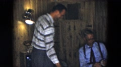 1961: joyful family get together filled with fun, games and smiles MICHIGAN Stock Footage