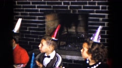 1961: children wearing party hats at a birthday party. MICHIGAN Stock Footage