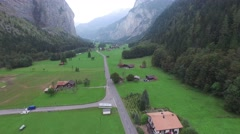 CINEMATIC FLY OVER ROAD AND TOWN IN LAUTERBRENNEN SWITZERLAND Stock Footage