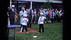 1961: two young girls in matching outfits show their dog at a dog show  Stock Footage