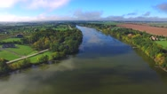 Beautiful rural shores of scenic river in autumn Stock Footage