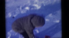 1964: the children play on the first evening of snow fall CAMDEN, NEW JERSEY Stock Footage