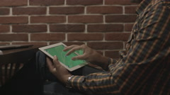 Man in plaid shirt uses touch screen tablet. Stock Footage