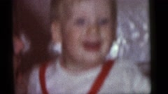 1964: small boy and his father laughing at each other. CAMDEN, NEW JERSEY Stock Footage