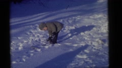 1964: children playing in the snow CAMDEN, NEW JERSEY Stock Footage