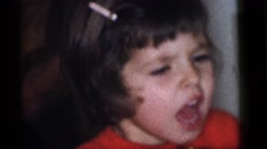 1964: children celebrate at a party with noisemakers while adults supervise Stock Footage
