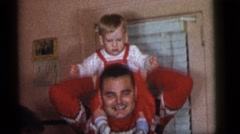 1964: father lift child on top playing happy love CAMDEN, NEW JERSEY Stock Footage