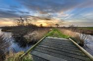 Walking track with bridge at sunset Stock Photos