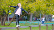 Portrait of adorable little girl outdoors at beautiful autumn day Stock Footage
