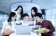 Asian business team and virtual chart Stock Photos