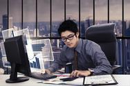 Asian businessman with virtual chart Stock Photos