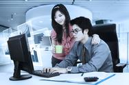 Asian businesspeople work with virtual chart Stock Photos