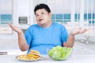 Asian person thinking to choose food Stock Photos