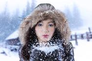 Beautiful woman blowing snow Stock Photos