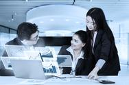 Business people discussing with virtual chart Stock Photos