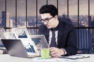 Businessman with virtual chart and coffee Stock Photos