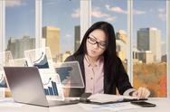 Businesswoman with chart and reminder book Stock Photos