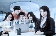 Businesswoman with partners and virtual chart Stock Photos