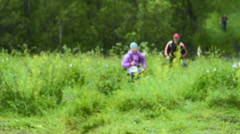 Male Runner. Tracking shot of male jogging and running on field. Stock Footage