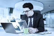 Caucasian businessman with virtual graph Stock Photos