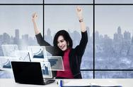 Cheerful businesswoman and virtual graph Stock Photos