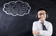 Child learns multilingual with headphones Stock Photos