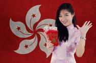 Girl wearing cheongsam dress holds envelope Stock Photos