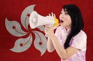 Girl with megaphone and flag of Hong Kong Stock Photos
