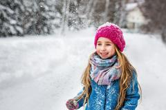 Portrait of a cute six year old girl with long blond hair, dressed in a blue Stock Photos