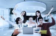Joyful businesspeople with virtual chart Stock Photos