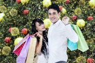 Lovely couple carries shopping bags Stock Photos