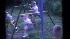 1964: children swinging while another child has a bat CAMDEN, NEW JERSEY Stock Footage