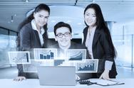 Workers with virtual chart smiling at camera Stock Photos