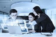 Workers with virtual graph in business meeting Stock Photos