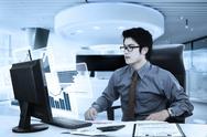 Young businessman looking at virtual chart Stock Photos