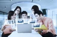 Young workers with virtual graph Stock Photos