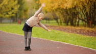 Active adorable little girl having fun at beautiful autumn park Stock Footage