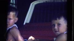 1963: two small boys wearing bibs sitting in truck bed waving LINCOLN, NEBRASKA Stock Footage