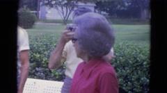 1963: nine people gathered in yard in residential area LINCOLN, NEBRASKA Stock Footage