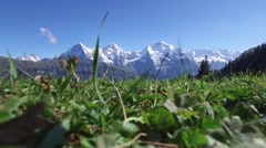 STATIC LOW ANGLE SHOT OF BEAUTIFUL SNOW CAPPED PEAKS Stock Footage